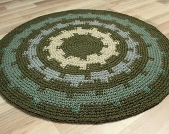 Stunning hand crocheted rug in moss green. Measures 36'' in diameter.