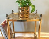 Brass tray table. Footed. Traditional gold. Interiors.