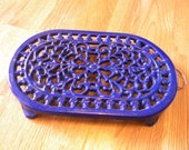 Cast iron trivet royal blue oval trivet or wall decor vintage kitchen decor