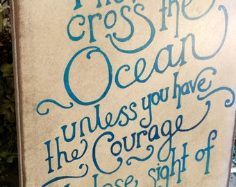 You can never cross the ocean unless you have the courage to lose sight of the shore Primitive Sign