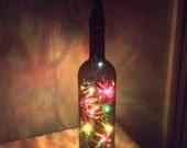 Wine bottle light/ multi color bottle light/ accent light/ night light/ nite lite/ dark Amber Bellini bottle with silver grape cluster top