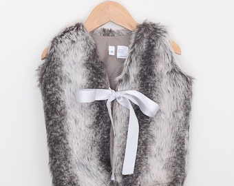 Faux Fur Vest for girls with grey ribbon.