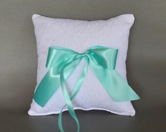 White lace wedding ring pillow with aqua satin ribbon bow