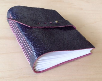 Leather sketchbook or journal with blank pages