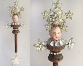mixed media assemblage, star ornament, original art doll, doll head ornament, altered art doll by Elizabeth Rosen