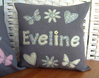 Grey/lemon yellow personalised cushion/pillow cover. Name, hearts, flowers, butterflies. Free-motion embroidered applique..