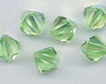 Eight rare vintage Swarovski crystal beads: Art. 364/5301 - 14 mm - peridot AB