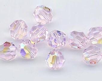 Twelve Swarovski crystals: art 5000 - 8 mm - rosaline AB