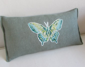 lumbar style toss pillow in seaside blue/green BURLAP with butterfly appliqued cutout