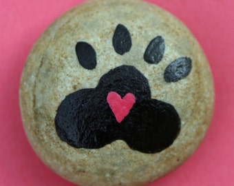 Painted garden rock, round river rock, painted pebble, pet memorial, stone, found item, paperweight, dog paw, heart, black and pink
