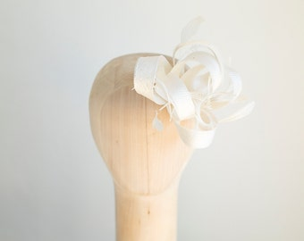 Bridal feather fascinator with birdcage veil, birdcage with millinery fascinator