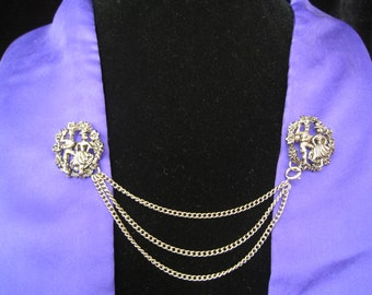 """SALE Sweater Guard Pin Set has 3 Chains.  1.25"""" Round Pins have Floral Border around Dancing Bavarian Couple. 3-Chain Swag. Spring C-Clasp."""