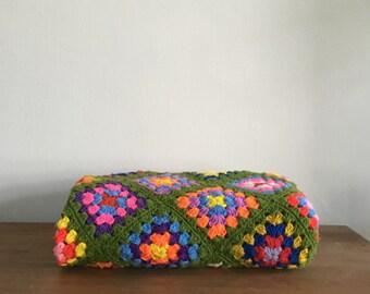 mid century neon granny square blanket. colorful rainbow crochet grannie square quilt. geometric interior design home decor throw blanket