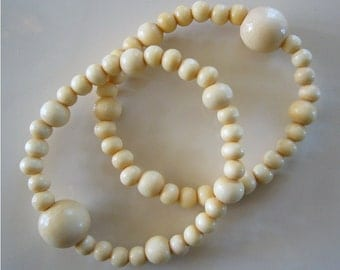"""Queasy Beads™ Motion Sickness Bracelets in """"French Vanilla"""" (wood beads)"""