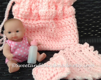 crochet cradle purse in solid pink with oh so cute doll in pink polka dot with bottle blanket and pillow