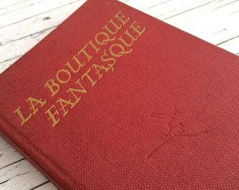 La Boutique Fantasque, a little red book.  The Story of Ballet by Marion Robertson with illustrations by Joyce Millen.