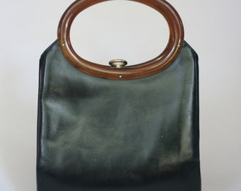 vintage rolfs black leather handbag with plastic oval handles