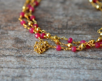 Gold ruby bracelet Red gemstone bracelet Multi layer beaded rosary chain bracelet Gold filigree dangle Multistrand bracelet July birthstone