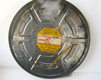 vintage extra large film canister from Eastman Kodak with original yellow label embossed 1960's
