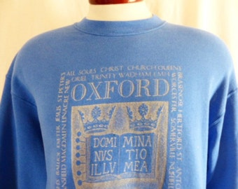vintage 80's 90's Oxford University blue fleece college graphic sweatshirt metallic silver crest logo print crew neck pullover jumper medium