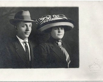 Old Photo Postcard Woman and Man wearing Hats 1910s Art Carver Ft Dodge Iowa Studio Cyko Rppc Photograph Snapshot vintage Couple