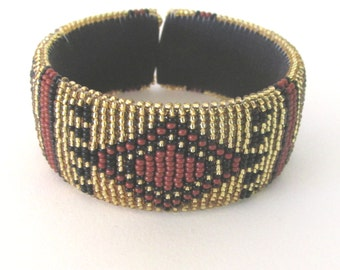Southwestern Native inspired gold red black beaded cuff
