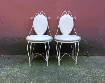pair of vintage wrought iron ice cream parlor chairs. retro distressed furniture. shabby chic decor.