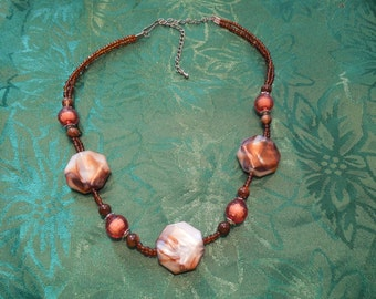 Vintage Bead Necklace.  Orange, Brown and Swirly Cream.