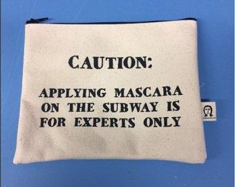 caution applying mascara  pouch