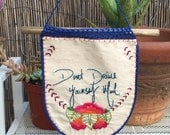 """Hand embroidered banner with crocheted embellishments with quote """"done drive yourself mad"""" .. Home decor .. Needle art"""