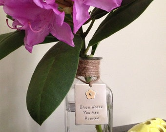 """Glass bottle with hand-stamped """"bloom"""" tag, housewarming, graduation or teacher gift, nickel silver with riveted brass flower, bud vase"""