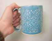 Reserved for  Donna Denham-Fleur-de-lys textured turquoise mug - hand built pottery