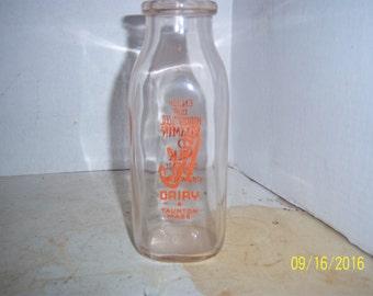 "1960's Cabral's Dairy Taunton, Mass Orange  Pyro  Pint milk dairy 7 1/2"" tall  cow bottle"