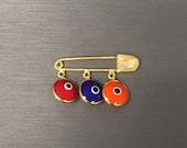 Hye Em Yes-Gold Evil Eye Safety Pin