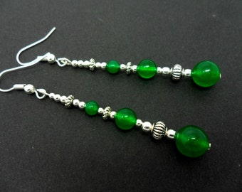 A pair of pretty green  jade   bead silver plated long dangly earrings.