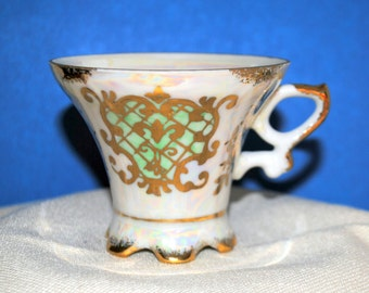 Royal Crown Pearl Luster Footed Cup and Saucer Floral and Grid pattern with lots of gilt