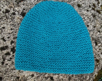 Hand knitted blue wool hat