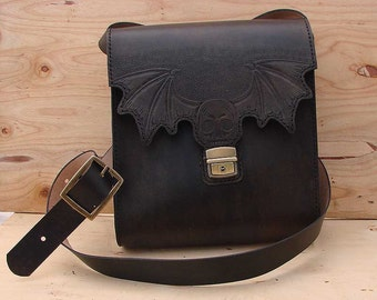 Messenger bag in cow leather with skull and bat wings