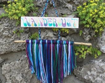 Wanderlust Wood Sign with Yarn Fringe