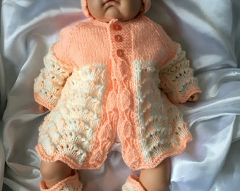 Hand knitted baby/reborn clothes