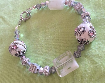White and silver bracelet with toggle clasp