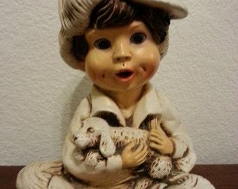 Ceramic Statue of Boy Holding Dog