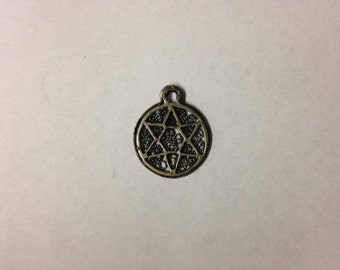 vintage necklace pendant - star of david with metal detailing around the star.