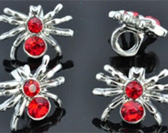 Silver spinnen-ring bead with red rhinestones with 4.5 mm-