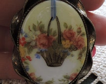 Vintage Oval Ceramic Hand Painted Basket of Flowers with Ribbon Twisted  Curled Beaded Frame Brooch~Reduced