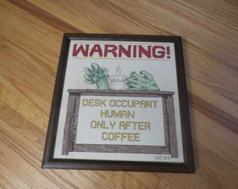 "1989 NEEDLEPOINT ""Warning! Desk Occupant Human Only After Coffee"" Initialed NO ""89 Wood Frame 12 1/4"" x 13 1/4"" No Glass"