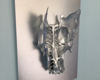 Chromed Bird Pelvis On Wall Plaque