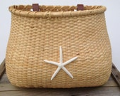 Nantucket style lightship bicycle basket handlebar with starfish coastal theme wedding favors, flowers or cards