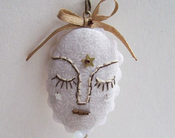 Embroidered face medal