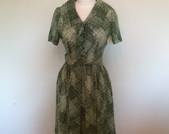 Gorgeous forrest green and white short sleeved  fit and flare sheer party dress by Kay Windsor